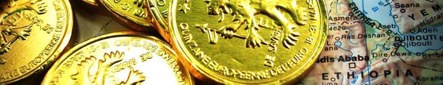 moedas de ouro e mapas de economia